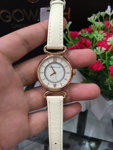 Anne Klein Women's 2192RGIV Glitter Accented Rose Gold-Tone and Ivory Strap Watch